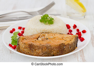 fish with boiled rice on the white plate