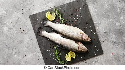 Fish with lemon on board - From above view of fresh trout...