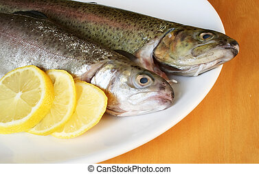 Fish with lemon on the plate