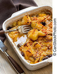 Fish with potatoes cooked in oven