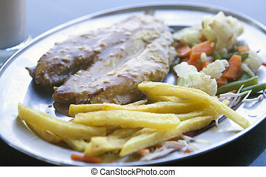 fish with potatoes on a plate