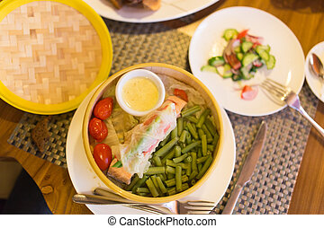 Fish with vegetables in a couple in a restaurant