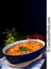 fish with vegetables in tomato sauce