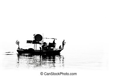 Fisher Boat - B&W Silhouette of a fisher boat at open sea.