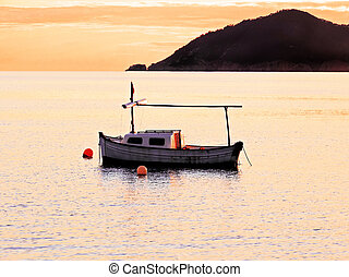 Fisher boat in the sunset