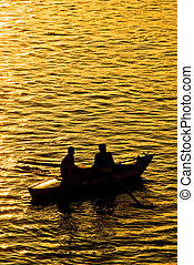 Fisher boat on the Nile River - Two fishers on the nile,...