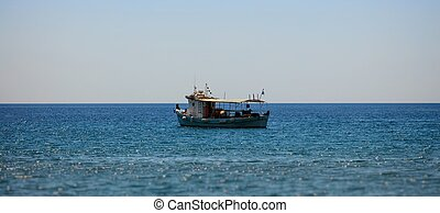 Fisher boat sailing on water - View on fisher boat on sea ...