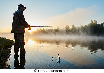 fisher fishing on foggy sunrise - Fisher man fishing with ...
