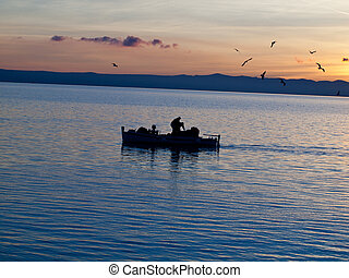 Fisher mans on blue sea
