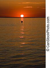 Fisherboat at sunset - fisherboat at an orange sunset.