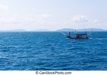 Fisherboat in blue sea