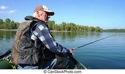 Fisherman - A fisherman in a boat is fishing