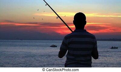 Angler fisherman trolling the rod