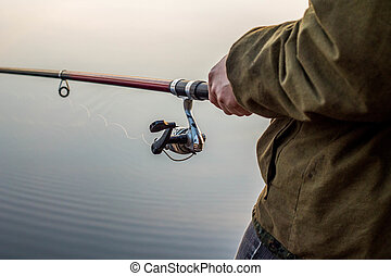 Fisherman at sunset fishing