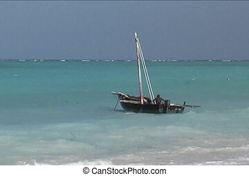 Fisherman bailing out his boat - Before going out into the...