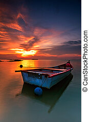Fisherman boat in the sunset