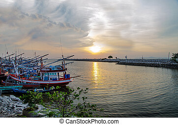 Fisherman boat with sunset