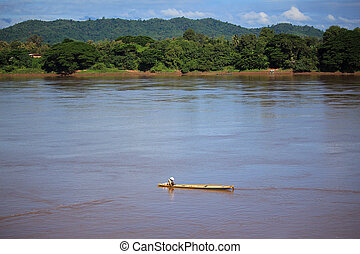 Fisherman cacth fish on the wooden boath in Mekong river, Thailand