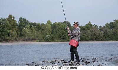 Fisherman catches a fish on a spinning