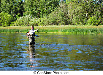 Fisherman catches of chub fly fishing in the Chusovaya river...