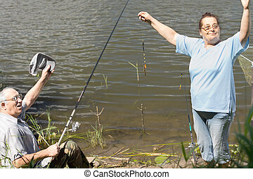 Fisherman celebrating the best catch of the day