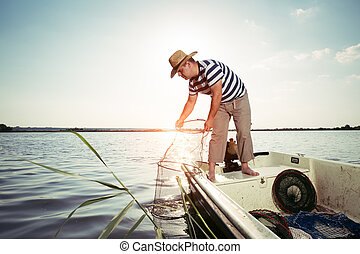 Fisherman checking the net for a catch