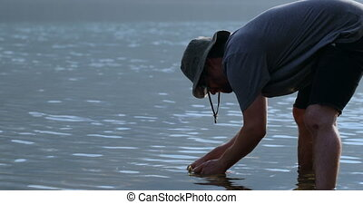 Fisherman cleaning a dead fish in the river 4k - Fisherman ...