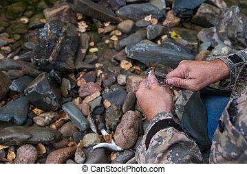 Fisherman cleaning fish