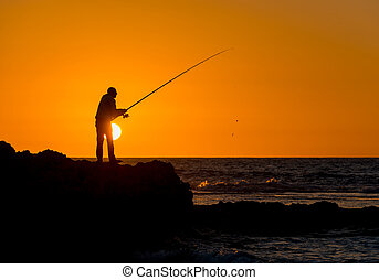 fisherman fishing at dawn