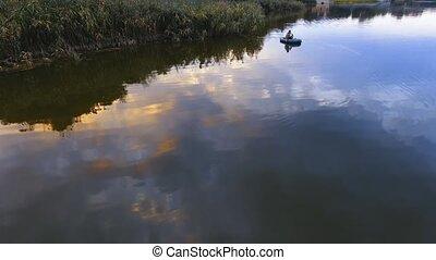 fisherman fishing from boat. Aerial camera shot.