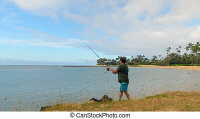 Fisherman fishing in the beach 4k - Senior fisherman fishing...