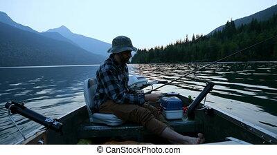 Fisherman fishing in the river 4k - Fisherman fishing in the...