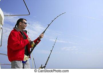 Fisherman fishing on boat big game tuna