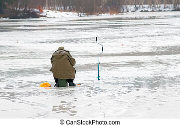 Fisherman fishing on the lake during the spring thaw