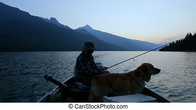 Fisherman fishing with his dog in the river 4k - Fisherman ...