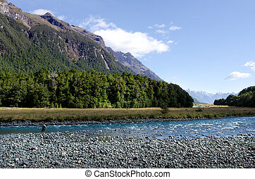Fisherman fly fishing in Fiordland