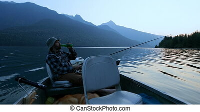 Fisherman having beer while fishing in the river 4k - ...