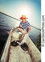 Fisherman Holding a Big Fish