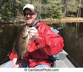 Fisherman holding a Smallmouth Bass