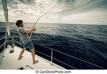 Fisherman in an ocean