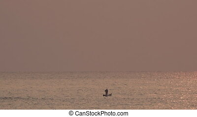 Traditional Fisherman over wooden boat in Lake Malawi at sunrise, text space at top