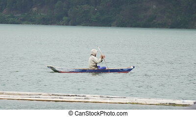 Fisherman in small boat on Lake Batur - Fisherman in a small...