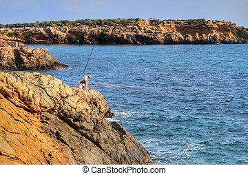Fisherman in the evening on Isla Plana beach in Cartagena