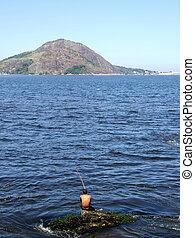 Fisherman in the sea