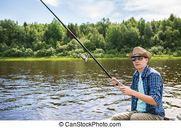 Fisherman is fishing on a river