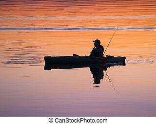 Fisherman kayaking
