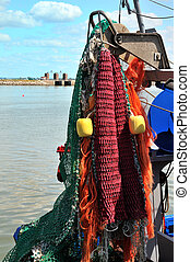 fisherman nets - Fisherman boat with many nets to catch the...