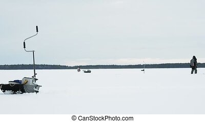 fisherman on a frozen lake ice fishing