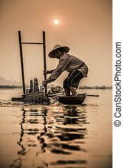 Fisherman on boat, Thailand