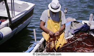 Fisherman on his boat.